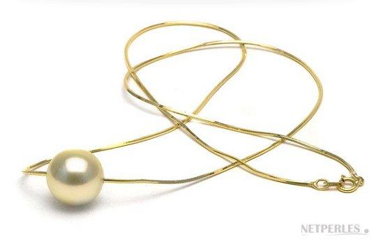 Chaine en or jaune traversante une perle d'australie doree
