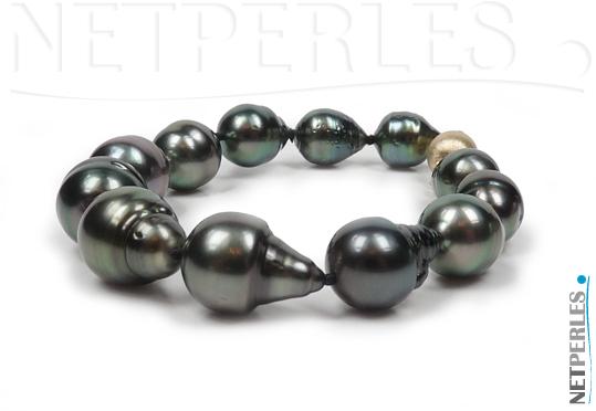 Bracelet de perles noires de tahiti, forme baroques, perles de 9,4 à 12,15 mm  sur 18 cm avec le fermoir de securite en Or jaune 14 carats