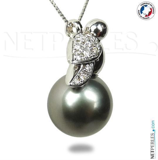 Pendentif perle de tahiti, forme oiseau en or 18 carats et diamants
