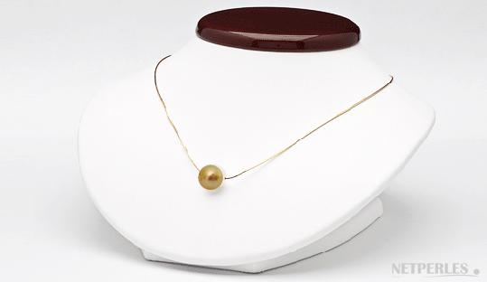 pendenfit perle de culture d'australie doree et chaine 14 carats traversante