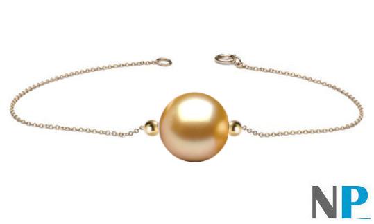 Bracelet chaine or 18 carats traversant une perle d'Australie dorée et deux billes en or