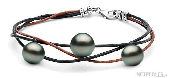 Bracelet de perles de culture de Tahiti montées sur lien de cuir entrelacés.